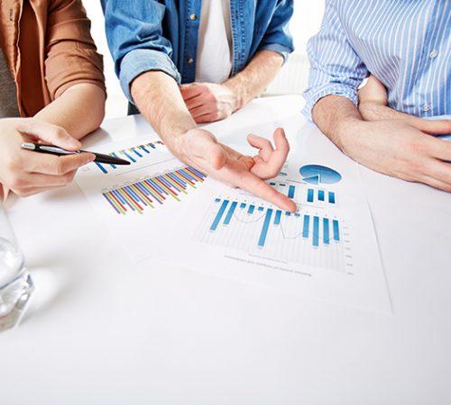 Hands of businessmen during presentation of market analysis